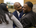Former NCAA college football player Torrey Green talks to defense attorney Skye Lazaro, left, and private investigator E. Christian Warmsley, background, during his rape trial, Tuesday, Jan. 15, 2019, in Brigham City, Utah. Green is accused of raping multiple women while he was a football player at Utah State. (Eli Lucero/The Herald Journal via AP)