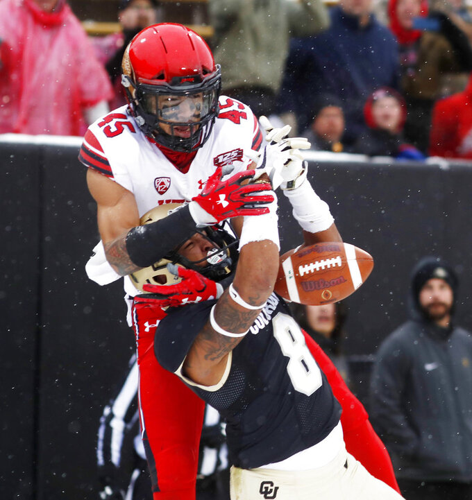 Colorado defensive back Trey Udoffia, front, breaks up a pass intended for Utah wide receiver Samson Nacua in the second half of an NCAA college football game Saturday, Nov. 17, 2018, in Boulder, Colo. Utah won 30-7. (AP Photo/David Zalubowski)
