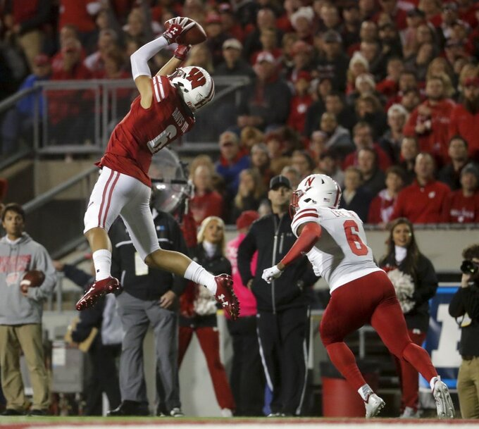 Wisconsin's Danny Davis III catches a pass in front of Nebraska's Eric Lee Jr. during the first half of an NCAA college football game Saturday, Oct. 6, 2018, in Madison, Wis. (AP Photo/Morry Gash)