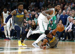 Indiana Pacers' Thaddeus Young tries to corral a loose ball in front of Boston Celtics' Kyrie Irving during the fourth quarter of an NBA basketball game Friday, March 29, 2019, in Boston. (AP Photo/Winslow Townson)