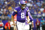 Minnesota Vikings quarterback Kirk Cousins runs off the field during the first half of an NFL preseason football game against the Arizona Cardinals, Saturday, Aug. 24, 2019, in Minneapolis. (AP Photo/Bruce Kluckhohn)