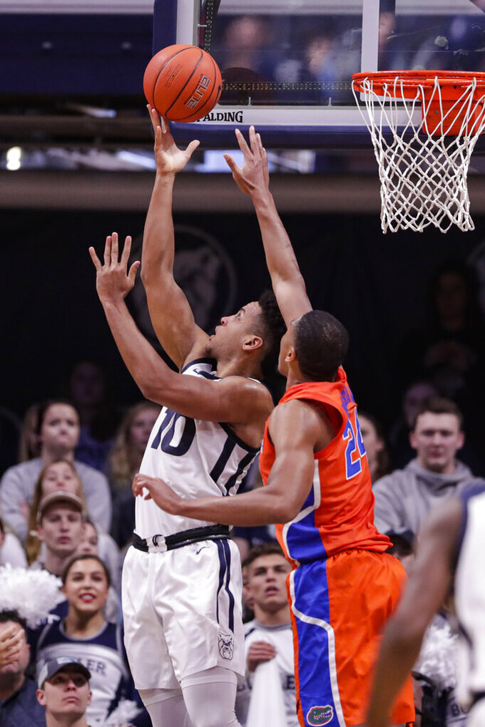 Butler forward Bryce Nze (10) shoots on Florida forward Kerry Blackshear Jr. (24) in the second half of an NCAA college basketball game in Indianapolis, Saturday, Dec. 7, 2019. Butler defeated Florida 76-62. (AP Photo/Michael Conroy)