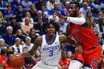 Kentucky's Tyrese Maxey, left, drives near Auburn's Danjel Purifoy, right, during the first half of an NCAA college basketball game in Lexington, Ky., Saturday, Feb. 29, 2020. (AP Photo/James Crisp)