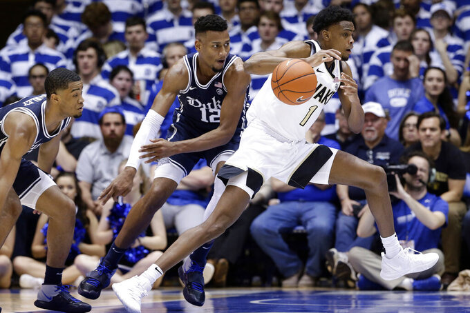 Duke forward Javin DeLaurier (12) guards against Wake Forest forward Isaiah Mucius (1) during the second half of an NCAA college basketball game in Durham, N.C., Saturday, Jan. 11, 2020. (AP Photo/Gerry Broome)