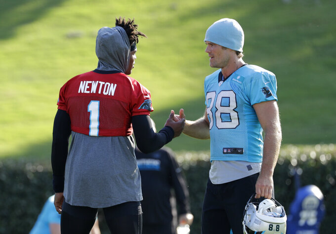 Carolina Panthers quarterback Cam Newton (1) greets tight end Greg Olsen (88) during practice at the NFL football team's training camp in Spartanburg, N.C., Thursday, July 25, 2019. (AP Photo/Chuck Burton)