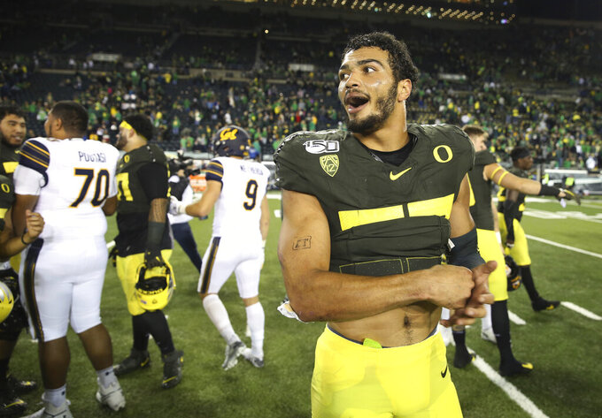Oregon's Troy Dye celebrates the Ducks' win over California at the end of an NCAA college football game Saturday, Oct.. 5, 2019, in Eugene, Ore. Oregon defeated California 17-7. (AP Photo/Chris Pietsch)