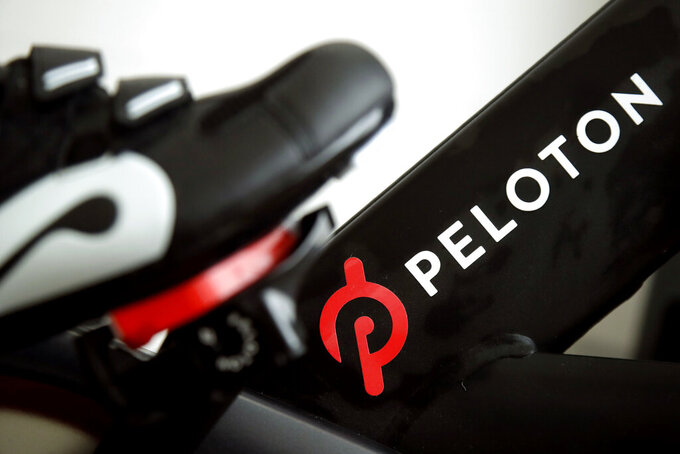 FILE - This Nov. 19, 2019 file photo shows the logo on a Peloton bike in San Francisco. Peloton's shares skidded in aftermarket trading Thursday, Aug. 26, 2021, after the exercise bike and treadmill company posted a loss for its most-recent quarter, showed slower revenue growth, and cut the price of its most-popular product.(AP Photo/Jeff Chiu, File)