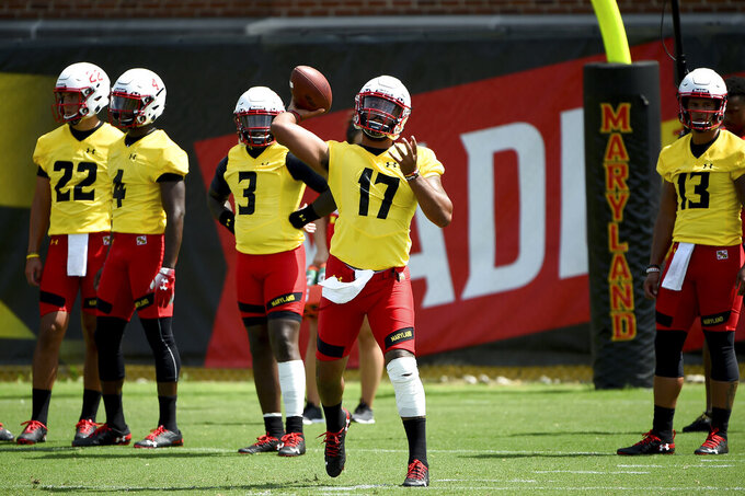 FILE - In this Aug. 2, 2019, file photo, Maryland quarterback Josh Jackson (17) works out during an NCAA college football training camp in College Park, Md. Following a miserable 2018 season, the Terrapins start anew Saturday with a home game against neighboring Howard. (AP Photo/Will Newton, File)
