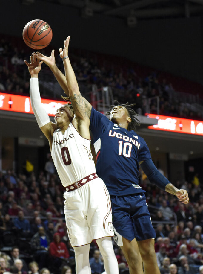 Temple's Alani Moore II (0) and Connecticut's Brendan Adams reach for a loose ball during the first half of an NCAA college basketball game, Wednesday, Feb. 6, 2019, in Philadelphia. (AP Photo/Michael Perez)