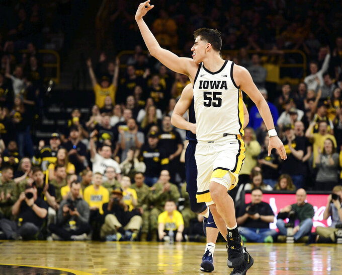Iowa's Luka Garza celebrates sinking a 3-pointer against Penn State during the first half of an NCAA college basketball game, Saturday, Feb. 29, 2020, in Iowa City, Iowa. (AP Photo/Cliff Jette)