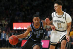 Duke guard Cassius Stanley (2) drives as Georgia Tech guard Michael Devoe (0) defends in the second half of an NCAA college basketball game Wednesday, Jan. 8, 2020, in Atlanta. Duke won 73-64. (AP Photo/John Bazemore)