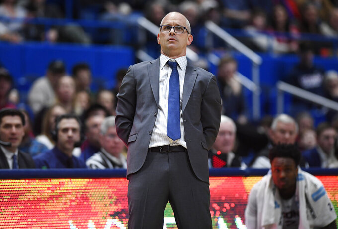 Connecticut head coach Dan Hurley leans back as his team shoots during the second half of an NCAA college basketball game against East Carolina, Sunday, Feb. 3, 2019, in Hartford, Conn. (AP Photo/Jessica Hill)