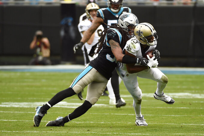 Carolina Panthers free safety Tre Boston (33) tackles New Orleans Saints wide receiver Michael Thomas (13) during the first half of an NFL football game in Charlotte, N.C., Sunday, Dec. 29, 2019. (AP Photo/Mike McCarn)