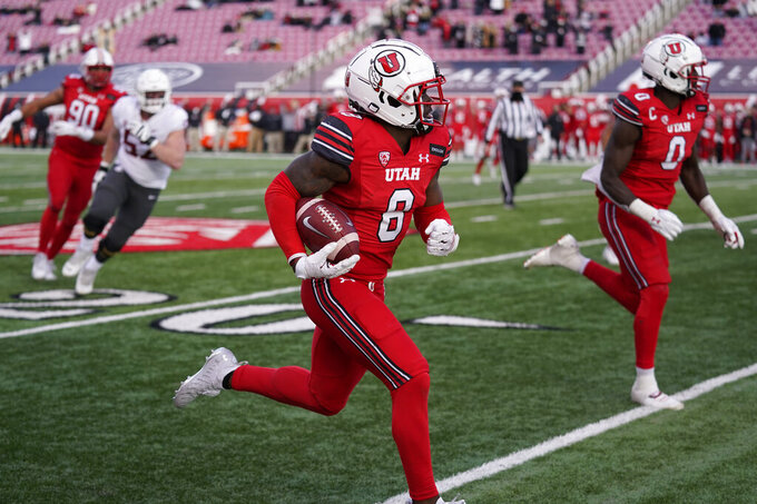 Utah cornerback Clark Phillips III (8) returns an interception for a touchdown against Washington State during the second half of an NCAA college football game Saturday, Dec. 19, 2020, in Salt Lake City. (AP Photo/Rick Bowmer)