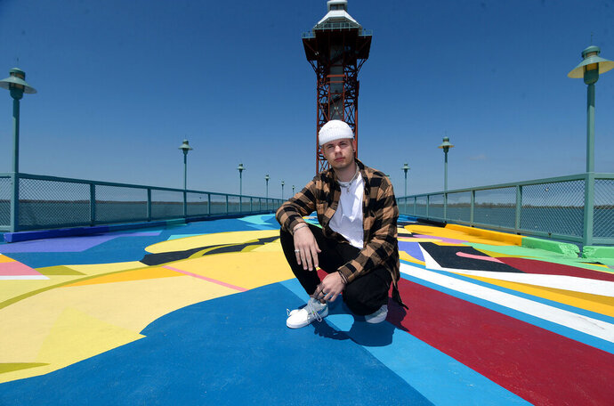 Carter Perkins, 21, a rapper and producer, who goes by the name Rozei, is shown May 12, 2020 at Dobbins Landing in Erie, Pa. The McDowell High School graduate recently signed a contract with Atlantic Records. (Jack Hanrahan/Erie Times-News via AP)