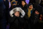 A woman mourns outside the Alberta Legislature Building in Edmonton, Alberta, Wednesday, Jan. 8, 2020, during a vigil for those killed after a Ukrainian passenger jet crashed, killing at least 63 Canadians, just minutes after taking off from Iran's capital. (Codie McLachlan/The Canadian Press via AP)