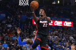 Miami Heat forward Jimmy Butler (22) goes to the basket in front of Oklahoma City Thunder center Nerlens Noel (9) during the first half of an NBA basketball game Friday, Jan. 17, 2020, in Oklahoma City. (AP Photo/Sue Ogrocki)