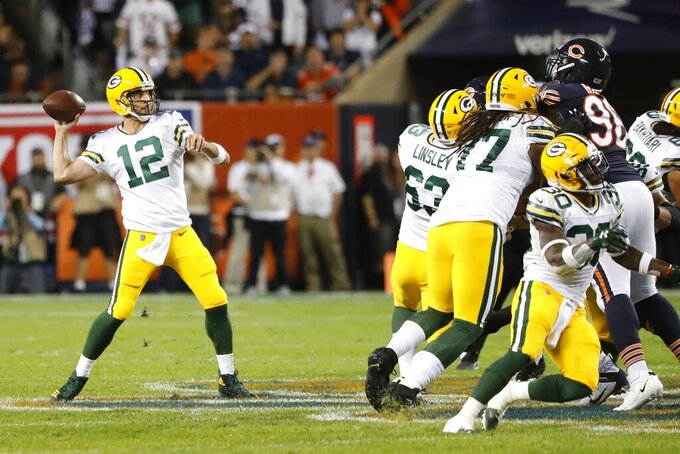 Green Bay Packers' Aaron Rodgers throws during the first half of an NFL football game against the Chicago Bears Thursday, Sept. 5, 2019, in Chicago. (AP Photo/Charles Rex Arbogast)