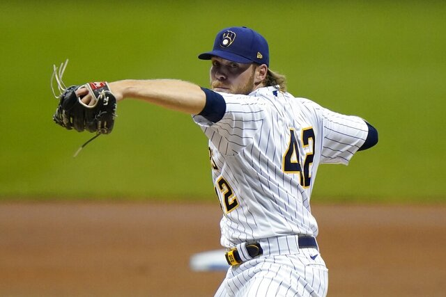 Milwaukee Brewers starting pitcher Corbin Burnes throws during the first inning of a baseball game against the Pittsburgh Pirates Friday, Aug. 28, 2020, in Milwaukee. (AP Photo/Morry Gash)