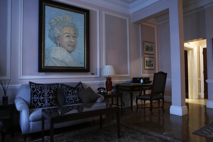 A painting of Britain's Queen Elizabeth II hangs in the reception area of the Stafford hotel near central London's St. James's Palace, Thursday, March 4, 2021. (AP Photo/Alastair Grant)