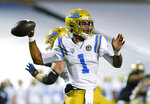 UCLA quarterback Dorian Thompson-Robinson looks to pass the ball against Colorado in the first half of an NCAA college football game Saturday, Nov. 7, 2020, in Boulder, Colo. (AP Photo/David Zalubowski)