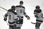 Los Angeles Kings defenseman Olli Maatta, center, celebrates an assist by defenseman Drew Doughty, left, on a goal by center Blake Lizotte, right, during the second period of an NHL hockey game against the Minnesota Wild in Los Angeles, Saturday, Jan. 16, 2021. (AP Photo/Kelvin Kuo)