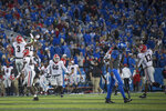 Georgia players celebrate victory after defeating Kentucky in an NCAA college football game in Lexington, Ky., Saturday, Nov. 3, 2018. (AP Photo/Bryan Woolston)