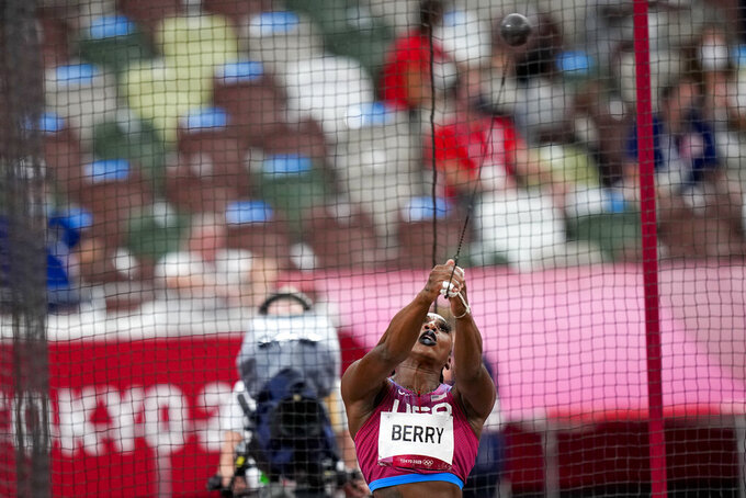 Gwen Berry, of the United States, competes in the women's hammer throw final at the 2020 Summer Olympics, Tuesday, Aug. 3, 2021, in Tokyo. (AP Photo/David J. Phillip)