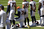 Denver Broncos offensive tackle Calvin Anderson (76) kneels during the national anthem before an NFL football game against the Pittsburgh Steelers in Pittsburgh, Sunday, Sept. 20, 2020. (AP Photo/Don Wright)