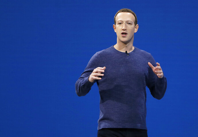 "FILE - In this May 1, 2018, file photo, Facebook CEO Mark Zuckerberg makes the keynote speech at F8, Facebook's developer conference, in San Jose, Calif. Zuckerberg says the company is evaluating how it should handle ""deepfake"" videos created with artificial intelligence and high-tech tools to yield false but realistic clips. He said in an interview Wednesday, June 26, 2019 that it may make sense to treat such videos differently from other misinformation such as false news. Facebook has long held that it should not decide what is and isn't true, leaving such calls instead to outside fact-checkers. (AP Photo/Marcio Jose Sanchez, File)"