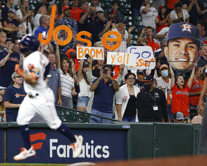 Fans cheer as Houston Astros Jose Altuve rounds the bases after hitting a solo home run off Cleveland Indians starting pitcher Triston McKenzie during the third inning of a baseball game Tuesday, July 20, 2021, in Houston. (Kevin M. Cox/The Galveston County Daily News via AP)