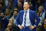Xavier head coach Travis Steele shouts from the sideline during the first half of an NCAA college basketball game against Villanova, Monday, Dec. 30, 2019, in Villanova, Pa. (AP Photo/Laurence Kesterson)