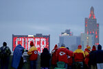 People gather at the Liberty Memorial as they wait for a parade through downtown Kansas City, Mo. to celebrate the Kansas City Chiefs victory in NFL's Super Bowl 54 Wednesday, Feb. 5, 2020. (AP Photo/Charlie Riedel)
