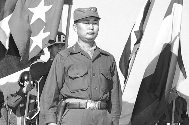FILE - This Oct. 29, 1953, file photo shows Gen. Paik Sun-yup on the reviewing stand in South Korea. Former South Korean army Gen. Paik who was celebrated as a major war hero for leading troops in several battle victories against North Korean soldiers during the 1950-53 Korean War, has died. He was 99. (AP Photo/Fred Waters, File)