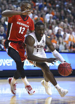 Auburn guard Jared Harper (1) drives past Georgia forward E'Torrion Wilridge (13) during the second half of an NCAA college basketball game Saturday, Jan. 12, 2019, in Auburn, Ala. (AP Photo/Julie Bennett)