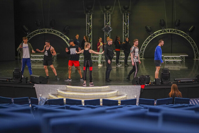 Dancers and actors practice in the theater of the MSC Grandiosa cruise ship in Civitavecchia, near Rome, Wednesday, March 31, 2021. MSC Grandiosa, the world's only cruise ship to be operating at the moment, left from Genoa on March 30 and stopped in Civitavecchia near Rome to pick up more passengers and then sail toward Naples, Cagliari, and Malta to be back in Genoa on April 6. For most of the winter, the MSC Grandiosa has been a lonely flag-bearer of the global cruise industry stalled by the pandemic, plying the Mediterranean Sea with seven-night cruises along Italy's western coast, its major islands and a stop in Malta. (AP Photo/Andrew Medichini)