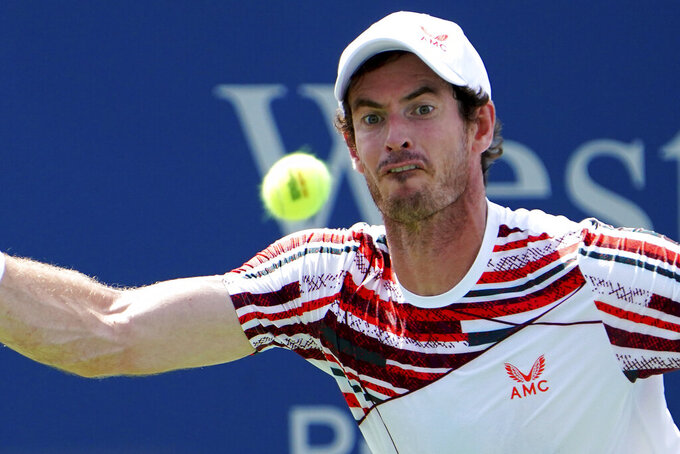 Andy Murray, of Britain, eyes the ball to return against Hubert Hurkacz, of Poland, Wednesday, Aug. 18, 2021, during the Western & Southern Open tennis tournament at the Lindner Family Tennis Center in Mason, Ohio. (Kareem Elgazzar/The Cincinnati Enquirer via AP)