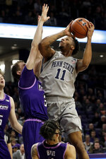 Penn State forward Lamar Stevens, right, goes up to shoot against Northwestern forward Robbie Beran during the first half of an NCAA college basketball game in Evanston, Ill., Saturday, March 7, 2020. (AP Photo/Nam Y. Huh)