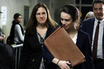 Assistant District Attorney Joan Illuzzi, left, leaves the courtroom of the Harvey Weinstein rape trial during the lunch break, in New York, Thursday, Feb. 13, 2020. (AP Photo/Richard Drew)