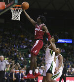 Alabama guard Kira Lewis Jr., left, scores past Baylor guard Jared Butler, right, during the first half of an NCAA college basketball game, Saturday, Jan. 26, 2019, in Waco, Texas. (Rod Aydelotte/Waco Tribune-Herald via AP)
