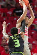 South Florida guard Laquincy Rideau (3) fouls Houston forward Fabian White Jr. (35) who shoots during the first half of an NCAA college basketball game Sunday, Jan. 26, 2020, in Houston. (AP Photo/Michael Wyke)