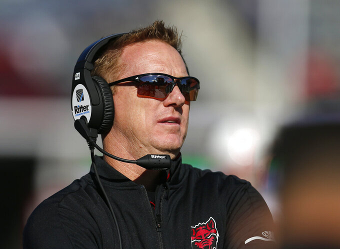 FILE - In this Saturday, Dec. 29, 2018, file photo, Arkansas State head coach Blake Anderson is pictured in the first half during an NCAA college football bowl game against Nevada, in Tucson, Ariz. Wendy Anderson, the wife of Arkansas State football coach Blake Anderson, died Monday, Aug. 19, 2019, after a two-year fight with breast cancer. She was 49. (AP Photo/Rick Scuteri, File)