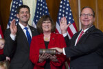 FILE - In this Jan. 3, 2017, file photo, then-House Speaker Paul Ryan of Wis. administers the House oath of office to Rep. Bill Flores, R-Texas, during a mock swearing in ceremony on Capitol Hill in Washington. Flores won't run for re-election in 2020, becoming the state's fifth Republican congressman to say he's leaving. The announcement Wednesday brings the number of House Republicans retiring next year to 15. (AP Photo/Jose Luis Magana, File)