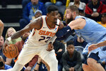Phoenix Suns center Deandre Ayton (22) handles the ball against Memphis Grizzlies center Jonas Valanciunas (17) in the first half of an NBA basketball game Sunday, Jan. 26, 2020, in Memphis, Tenn. (AP Photo/Brandon Dill)