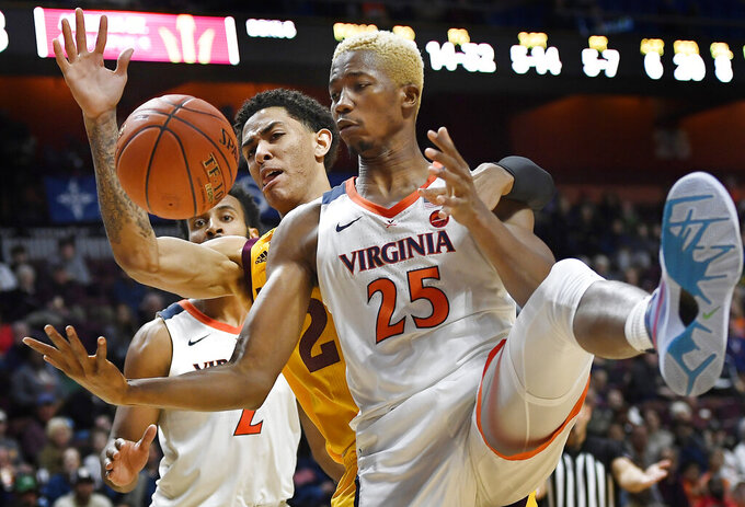 Arizona State's Jalen Graham, center left, and Virginia's Mamadi Diakite (25) fight for a rebound during the second half of an NCAA college basketball game, Sunday, Nov. 24, 2019, in Uncasville, Conn. (AP Photo/Jessica Hill)