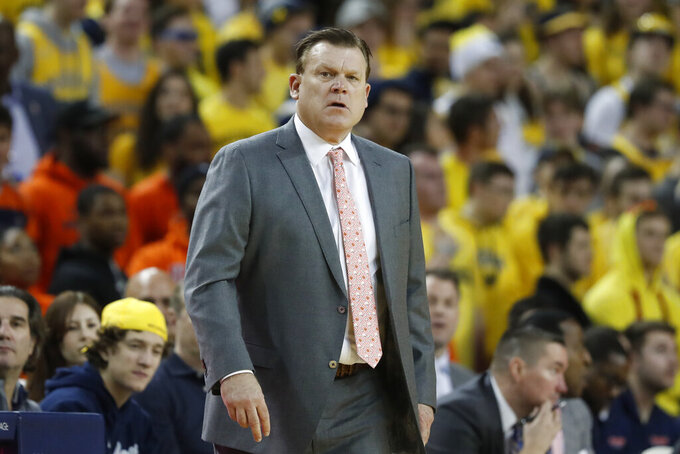 "FILE - In this Jan. 25, 2020, file photo, Illinois coach Brad Underwood watches from the sideline during the first half of the team's NCAA college basketball game against Michigan in Ann Arbor, Mich. Excluding a scheduled Dec. 8 game at No. 9 Duke, the Illini have not announced details of when or who they will play once the season officially starts Nov. 25. ""Welcome to COVID 2020,"" Underwood said. ""There are so many unknowns right now. I have all these plans on my desk to deal with whatever might come up. But what is known is our roster. I'm very excited."" (AP Photo/Carlos Osorio, File)"