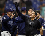 Tampa Bay Rays' Ji-Man Choi, right, celebrates his walkoff home run off New York Yankees relief pitcher Cory Gearrin during the 12th inning of a baseball game Tuesday, Sept. 24, 2019, in St. Petersburg, Fla. (AP Photo/Chris O'Meara)