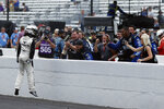 AJ Allmendinger celebrates with his crew after winning a NASCAR Series auto race at Indianapolis Motor Speedway, Sunday, Aug. 15, 2021, in Indianapolis. (AP Photo/Rob Baker)