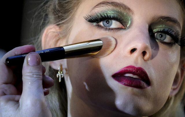 A model is styled backstage before appearing in the Anna Sui fashion show during New York's Fashion Week, Monday Feb. 10, 2020. (AP Photo/Bebeto Matthews)