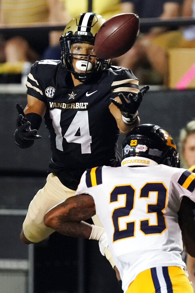 Vanderbilt wide receiver Will Sheppard (14) reaches for a pass over East Tennessee State defensive back Mike Price (23) in the first half of an NCAA college football game Saturday, Sept. 4, 2021, in Nashville, Tenn. (AP Photo/Mark Humphrey)